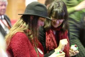 Sally Nicholls showing me that the baubles we'd been given unscrewed to reveal chocolate (Photo courtesy of KT Bruce Photography)