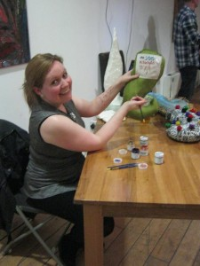 Anne Perry, maker of the tentacles, painting on the winners' names